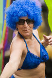 Amsterdam Gay Pride. August man in blue Afro wig & bikini top Prinsengracht canal Stock Photography