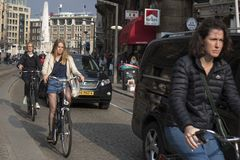 People on the street in Amsterdam Stock Photo