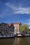 Amsterdam, Holland. Canal front buildings and blue sky Royalty Free Stock Photography
