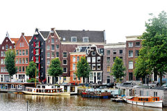 Amsterdam, Holland, Europe - scenic view of the canal, boats and buildings. Amsterdam, Holland, Europe - scenic view of the canal, boats and typical dutch Stock Photography