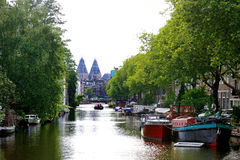 Amsterdam, Holland, Europe - scenic view of the canal, boats and trees. Amsterdam, Holland, Europe - scenic day view of the canal, boats and trees Royalty Free Stock Photography