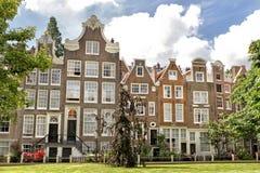 amsterdam holland houses traditionellt Arkivbild