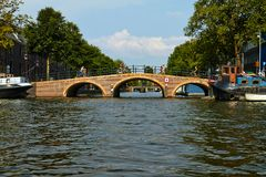 Canals and boats of Amsterdam stock photos