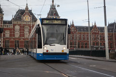 AMSTERDAM, HOLLAND - MAY 13: Tram running in the city centre amongst pedestrians. Royalty Free Stock Photography