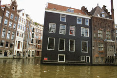 Amsterdam, Holland - traditional houses and canals in the city Stock Photography