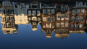 Beautiful canal houses in Amsterdam. Typical Amsterdam houses, reflected in a canal Royalty Free Stock Photography