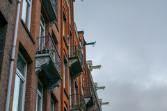 Amsterdam houses with balconies and hooks Stock Photography