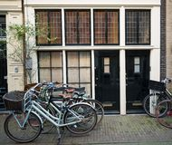 Amsterdam houses with bicycles Royalty Free Stock Photography