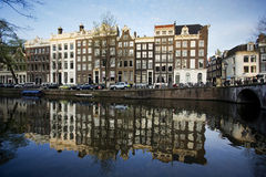 Amsterdam houses on a canal. In the evening Stock Images