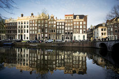 Amsterdam houses on a canal. In the evening Stock Photography