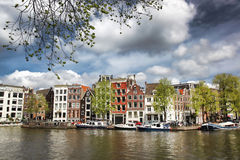 Amsterdam with houses near the  canal in Holland Stock Photo