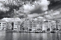 Amsterdam with houses near the  canal in Holland Stock Images