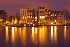 Amsterdam houses by night in Netherlands Royalty Free Stock Image