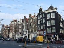 Amsterdam inclinava le costruzioni Fotografia Stock