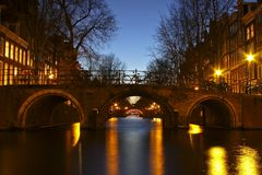 Amsterdam innercity by night in Netherlands Stock Photos