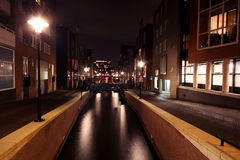 Amsterdam innercity by night in Netherlands Stock Photo