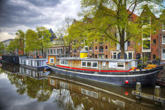 Amsterdam. And its canals where boats sail home royalty free stock photo