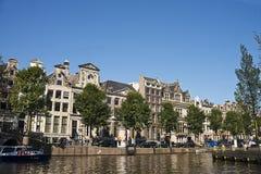Amsterdam kanaler, Nederländerna Arkivbild