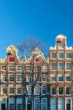 Amsterdam kanalhus i vinter Arkivbild