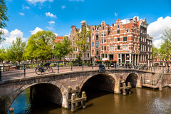 Amsterdam Leaning Buildings and Canals. Famous Amsterdam Leaning Buildings and Canals Royalty Free Stock Photography