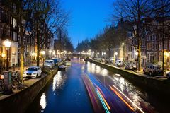 Amsterdam, Leidsegracht Canal at Night. Amsterdam , view of Leidsegracht canal at night. It can be seen at center the bell friar of the Catholic Church Royalty Free Stock Image