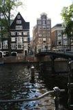 Amsterdam Life. Canal bridge in Amsterdam at dusk royalty free stock photos