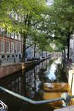 Amsterdam_Life_2. Canal bridge in Amsterdam at dusk stock image