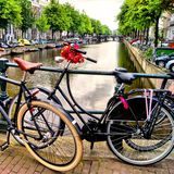 Amsterdam lifestyle. Bicycle along a canal in Amsterdam, the Netherlands (HDR processing Royalty Free Stock Photos