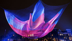 Amsterdam light festival. A cultural festival of light and water. This light art object is a huge fishnet above the Amstel canal Stock Photo