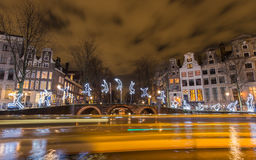 Amsterdam Light Festival - Run beyond. Tour boats decorate the canals with light trails as they are cruising the exhibition boat route `Water Colors`, part of Royalty Free Stock Photos