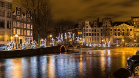 Amsterdam Light Festival - Run Beyond. Tour boats decorate the canals with light trails as they are cruising the exhibition boat route `Water Colors`, part of Royalty Free Stock Photography