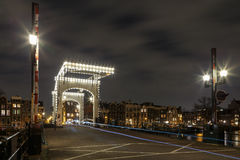 Amsterdam magere brug. Amsterdam the `magere brug` the lights are turned on at night royalty free stock image