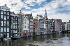 Amsterdam magra hus arkivfoto