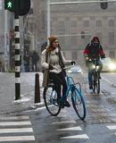 Amsterdam a man and a woman on a bicycle royalty free stock image