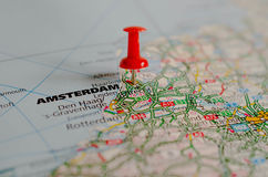 Amsterdam on map. Macro shot of Amsterdam on map with a red push pin stock image