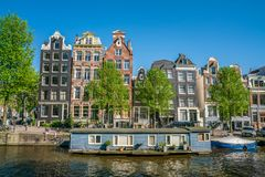 Amsterdam, May 7 2018 - The Brouwersgracht with traditional houses and floating houses stock photography