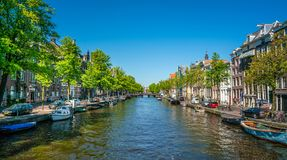 Amsterdam, May 7 2018 - the Kloveniersburgwal channel with a vie royalty free stock photo