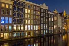 Amsterdam medieval houses by night in Netherlands Stock Image