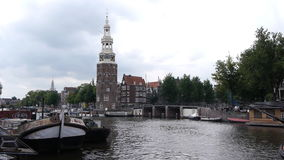 Amsterdam Montelbaans Tower and canal. Clip of the Montelbaans Tower and canals in Amsterdam stock video footage