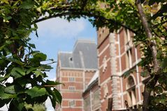 Amsterdam - National Museum. Building - through tree Royalty Free Stock Images