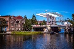 AMSTERDAM NEDERLÄNDERNA - AUGUSTI 15, 2016: Berömda byggnader av närbilden för Amsterdam stadsmitt Allmän landskapstadssikt Royaltyfria Bilder