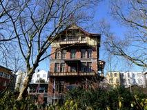 AMSTERDAM NEDERLÄNDERNA - MARS 13, 2016: Amsterdamsche Huish Royaltyfri Bild