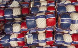 Amsterdam, Nederland. Shop window of a food store with traditional Dutch cheeses. Red, white, and blue plastic packaging royalty free stock image