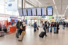 AMSTERDAM, NETHERLAND - OCTOBER 18, 2017: International Amsterdam Airport Schiphol Interior with Passengers. Screens and People in. International Amsterdam Royalty Free Stock Photography
