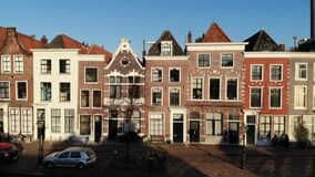 Amsterdam Netherlands aerial view at day. Old dancing houses, river Amstel, canals with bridges, old european city