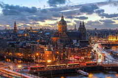 Amsterdam, Netherlands. Aerial view of downtown Amsterdam, The Netherlands during a dramatic beautiful sunset. Almost all of the most proeminent landmarks are Stock Photography