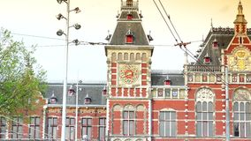 AMSTERDAM, NETHERLANDS :Amsterdam Central Train Station in Amsterdam.ULTRA HD 4k, real time. AMSTERDAM, NETHERLANDS :Amsterdam Central Train Station in Amsterdam stock video footage