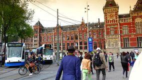 AMSTERDAM, NETHERLANDS :Amsterdam Central Train Station in Amsterdam.ULTRA HD 4k, real time. AMSTERDAM, NETHERLANDS :Amsterdam Central Train Station in Amsterdam stock video