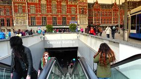 AMSTERDAM, NETHERLANDS :Amsterdam Central Train Station in Amsterdam.ULTRA HD 4k, real time. AMSTERDAM, NETHERLANDS :Amsterdam Central Train Station in Amsterdam stock footage