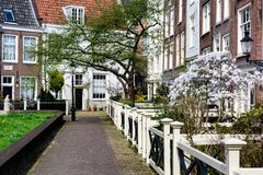 Free AMSTERDAM, NETHERLANDS - APRIL 11, 2018: Begijnhof Is One Of The Oldest Inner Courts In The City Of Amsterdam. A Group Of Historic Royalty Free Stock Images - 129222959